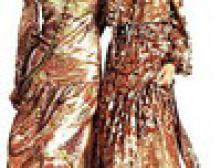 Вновь входит мода на макси юбки и платья